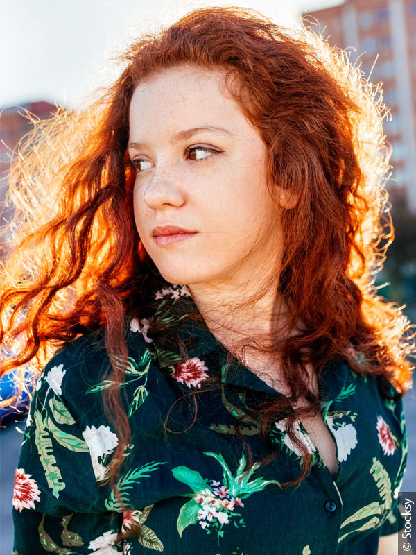 600x800_redheaded-woman-with-flower-blouse